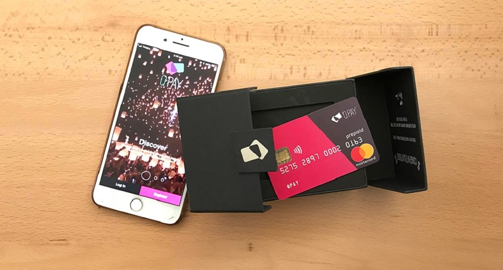 Mobile phone with the QPay app loaded and the new QPay mastercard on a table,