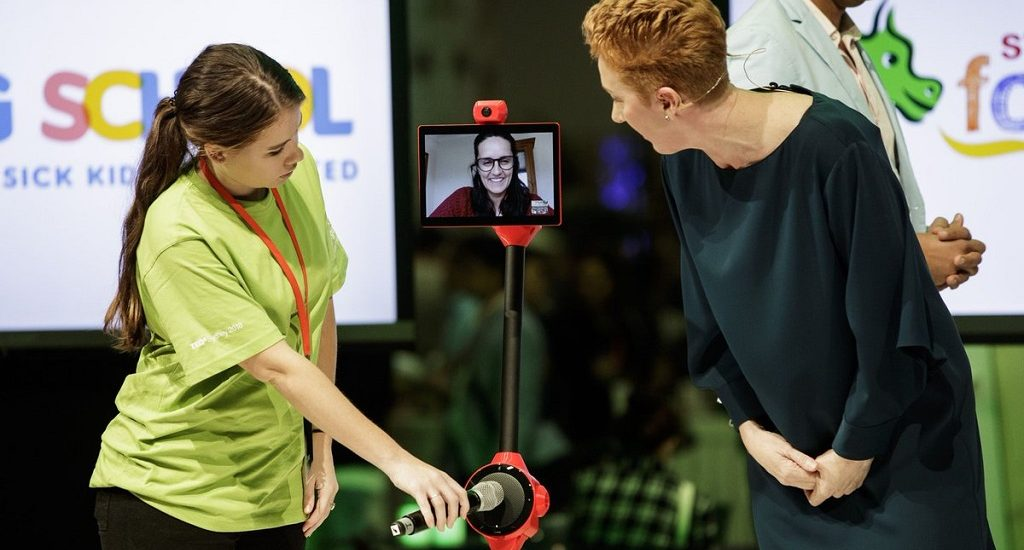 Meghan Gilmour, founder of MissingSchool demonstrating the robots.