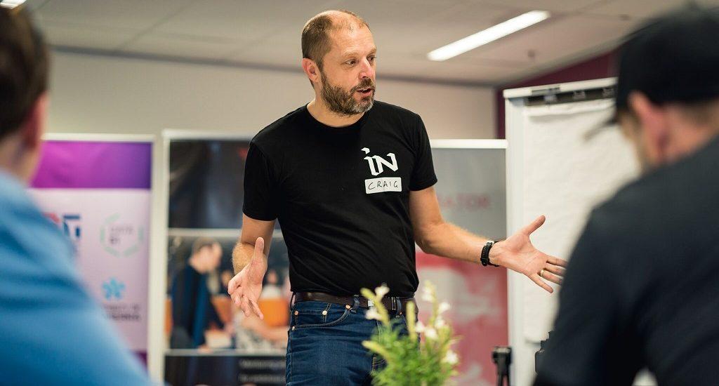 Man facilitates a workshop