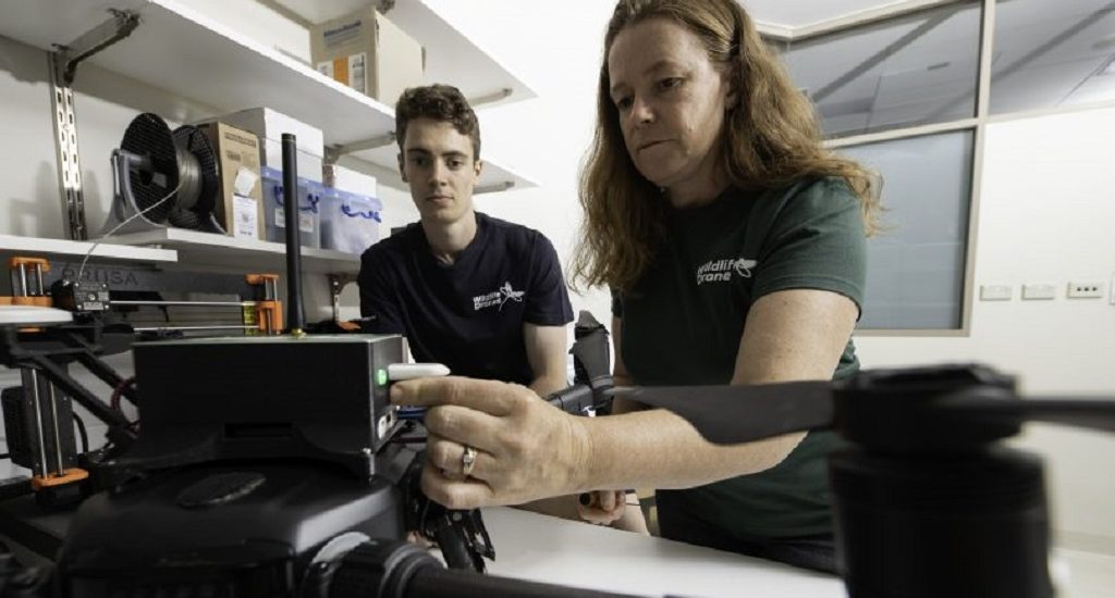 Dr Debbie Saunders and Liam Kennedy setting up the animal-tracking drone in the lab