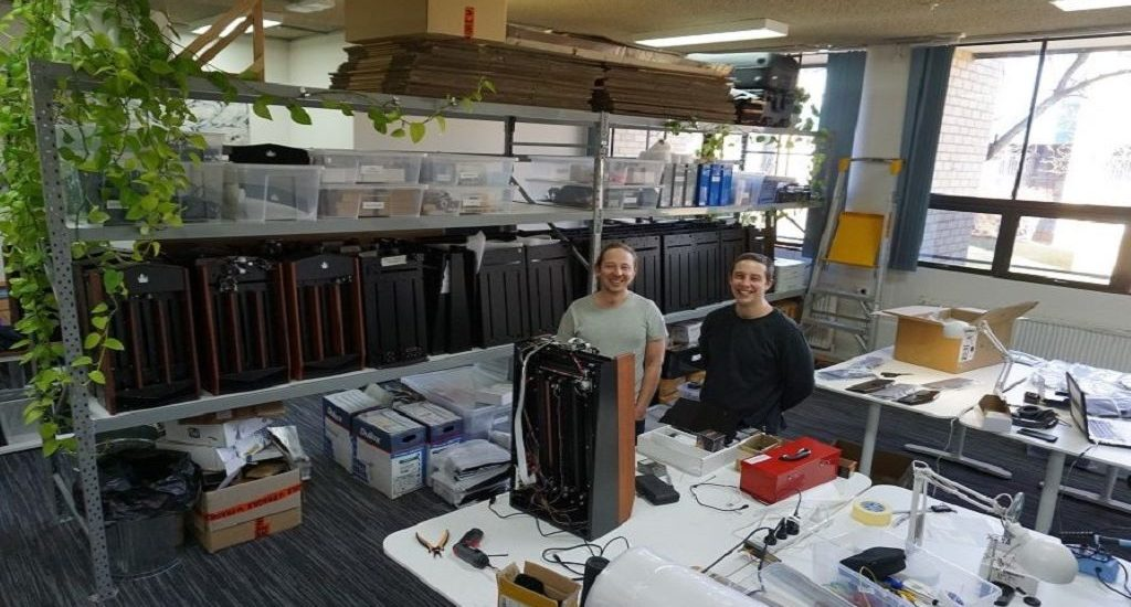 CardCastle's founders in their new offices